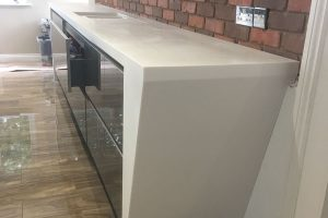 Staron Yukon Metallica Kitchen Worktops next to Brick Wall