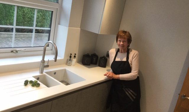 Happy Customer with Snow Pearl surfaces