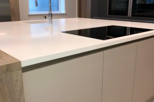 30mm Corian Glacier White seamless oversized worktop with an integrated sink