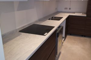 Luna Cararra Colour by Tristone to finish two tone kitchen